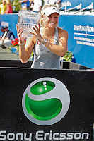 April 11, 2010:  MPS Group Championships.  Caroline Wozniacki (DEN) displays her winning trophy with the sponsor logo, Sony Ericsson in the foreground during finals singles action at the MPS Group Championships played at the Sawgrass Country Club in Ponte Vedra, Florida.  Caroline Wozniacki (DEN) defeated Olga Govortsova (BLR) 6-2, 7-5 to win the tournament for the second consecutive year..