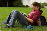 Lindsey Passic (linz2428@aol.com) takes advantage of the nice weather to study her scriptures on the lawn...Aug. 22, 2004.Day in the life of BYU..Photo by Steve Walters/BYU.0409-30 GCS Day at BYU.
