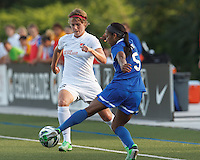 Boston Breakers midfielder Jazmyne Avant(5) works to clear ball as Sky Blue FC midfielder Sophie Schmidt (16) defends. In a National Women's Soccer League (NWSL) match, Boston Breakers (blue) defeated Sky Blue FC (white), 3-2, at Dilboy Stadium on June 30, 2013.