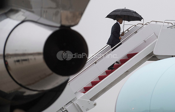 United States President Barack Obama boards Air Force One as he leaves for a day trip to Tampa, Florida at Joint Base Andrews, Maryland on December 6, 2016. <br /> Credit: Kevin Dietsch / Pool via CNP /MediaPunch