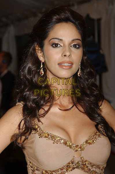 """MALLIKA SHERAWAT.At the 'The Myth' premiere held at Roy Thomson Hall,.At The Toronto Film Festival,.Toronto, 15th September 2005.portrait headshot cream gold sequin trim dress cleavage.Ref"""" ADM/LF.www.capitalpictures.com.sales@capitalpictures.com.© Capital Pictures."""