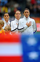 Abby Wambach (r), Lauren Cheney (C) and Alex Krieger of team USA during the FIFA Women's World Cup at the FIFA Stadium in Moenchengladbach, Germany on July 13th, 2011.