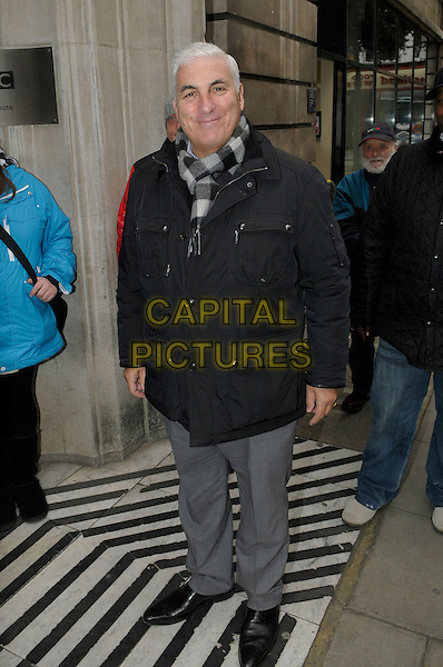 Mitch Winehouse .At BBC Radio 2 London, England..November 9th, 2012.full length black jacket grey gray trousers check scarf.CAP/IA.©Ian Allis/Capital Pictures.