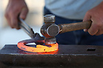 Josh Dittmer competes in the American Farriers Association event at the NV150 Fair at Fuji Park, in Carson City, Nev., on Friday, Aug. 1, 2014.<br /> Photo by Cathleen Allison