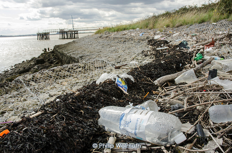 Plastic bottles, seaweed and other debris washed up on the Kent shore of the Thames estuary near Gravesend.