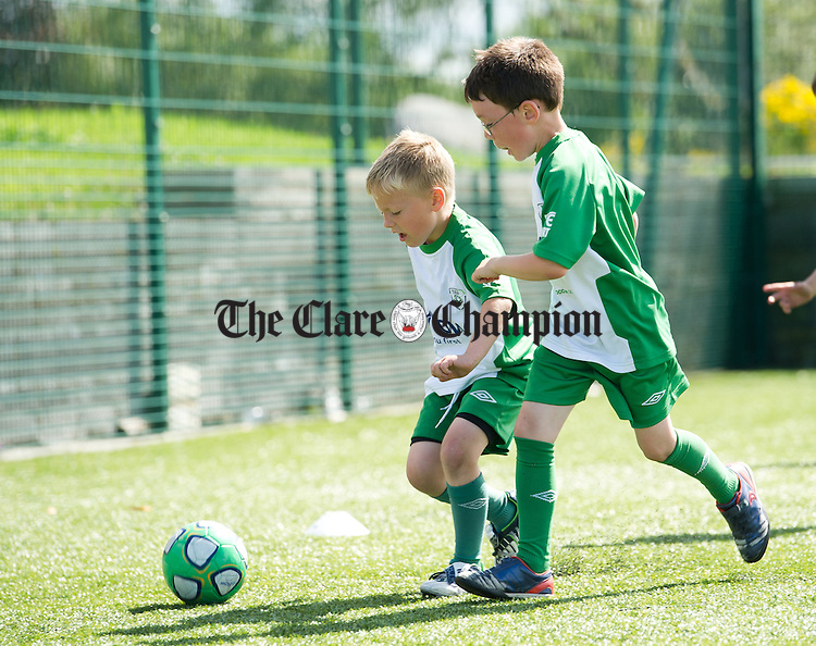 John Curtin in action against Conor O Neill during the Burren United FAI Summer Soccer School at Lisdoonvarna. Photograph by John Kelly.