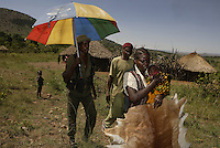 Woman arrested for having three impala skins is Boke-Marwa and the village is Nyansurura. .Paul Jones (the Jones of Dow Jones) has pumped 20 million dollars into Grumeti Reserve and conservation efforts to date and has nothing yet that will recoup that money.  Before he can bring wealthy tourists in on their lear jets, he has to bring the animals back into Grumeti Reserve.  To do that, he and his team are doing everything right for conservation.  The human bycatch from their private army of anti-poaching team is another story, but in terms of conservation, they are doing a great job.  ..Their anti poaching effort has probably just moved the big-time poachers elsewhere.  This private army has no authority to do house to house searches, but they do anyway.  Money talks and this army brings a local policeman and Park Ranger in tow.  If the policeman discovers a little marijuana, it can mean 6 months in jail for the offender... Even though everyone knows all the Wakuria grow pot... The private army has been so effective, however, that the wildlife probably will come back to where the wealthy tourists can view it from their infinity-edge pool at their $2000 a night luxury home.  But the human bycatch is too severe and hostility is building up in the communities...The Grumeti Reserves are trying to reshape the entire northeast corner of the park area.  They hire 1400 workers from the neighboring communities and have an extensive outreach program.  They are trying to create programs where they can replace the protein lost from their crack down on poaching.  They have a fish farm program with the Heifer project that allows folks to farm Tilapia.  They also employ only people from the local villages to do construction. They are developing a five star hotel and an exclusive camp that will cost 1500 to $2000 a night and only put 40 more tourists a day into the park.  Albeit by helicopter.  They are pumping money back into the community (unlike the Masai situation) and have to