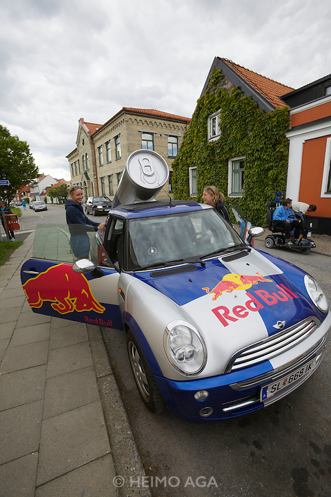 Ystad. Red Bull Mini girls giving out free samples.