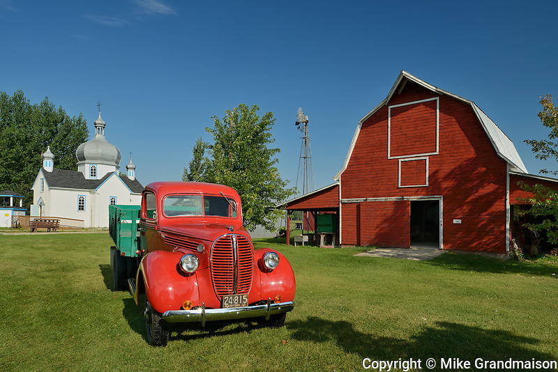 Old truck and barn at Fort la Reine Museum<br /> Portage La Prairie<br /> Manitoba<br /> Canada