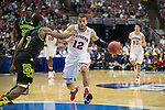 Wisconsin Badgers guard Traevon Jackson (12) leads a fast break during  a regional semifinal NCAA college basketball tournament game against the Baylor Bears Thursday, March 27, 2014 in Anaheim, California. The Badgers won 69-52. (Photo by David Stluka)