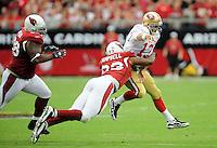 Sept. 13, 2009; Glendale, AZ, USA; Arizona Cardinals defensive end (93) Calais Campbell tackles San Francisco 49ers quarterback Shaun Hill at University of Phoenix Stadium. San Francisco defeated Arizona 20-16. Mandatory Credit: Mark J. Rebilas-