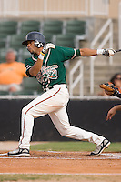 Emilio Ontiveros (11) of the Greensboro Grasshoppers follows through on his swing at Fieldcrest Cannon Stadium in Kannapolis, NC, Saturday August 24, 2008. (Photo by Brian Westerholt / Four Seam Images)