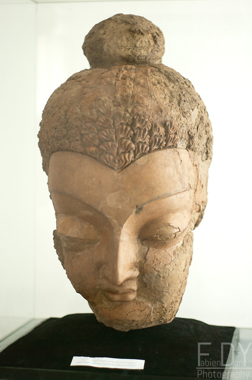 Head of Buddha statue made of clay. Dated 5-7th century AD, found in Tepe Sardar, Ghazni Province, Afghanistan. Kabul National Museum