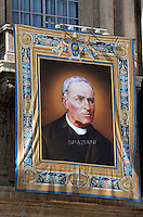 A tapestry showing Vincenzo Grossi hang from the balconies of St. Peter's in Vatican. --Pope Francis celebrates a Holy Mass for the canonization of four new saints: Vincenzo Grossi, Mary of the Immaculate Conception, Louis Martin and his wife Zélie Guérin, the first-ever married couple with children to be canonized in the same ceremony.Vatican City, Vatican. 18th October 2015