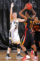 25 November 2011:  FIU guard Zsofia Labady (3) defends Maryland guard Laurin Mincy (1) in the second half as the University of Maryland Terrapins defeated the FIU Golden Panthers, 84-52, at the U.S. Century Bank Arena in Miami, Florida.