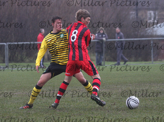 Thomas Reilly being closed down by Jackson Irvine in the St Mirren v Celtic Clydesdale Bank Scottish Premier League U19 match played at McKenna Park, Glasgow on 24.1.12...