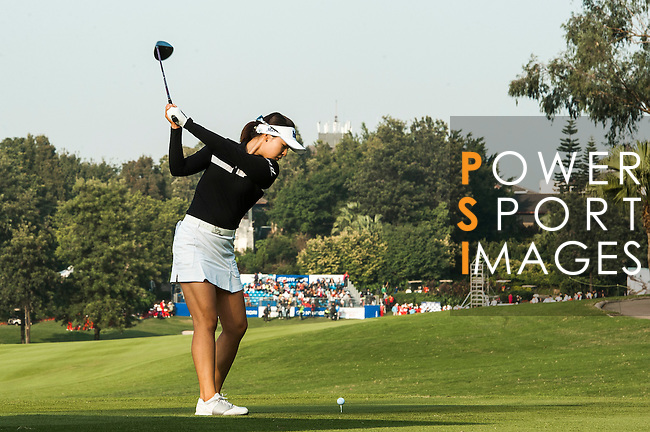 In-Gee Chun of Korea hits her shot during the Hyundai China Ladies Open 2014 at World Cup Course in Mission Hills Shenzhen on December 14 2014, in Shenzhen, China. Photo by Xaume Olleros / Power Sport Images