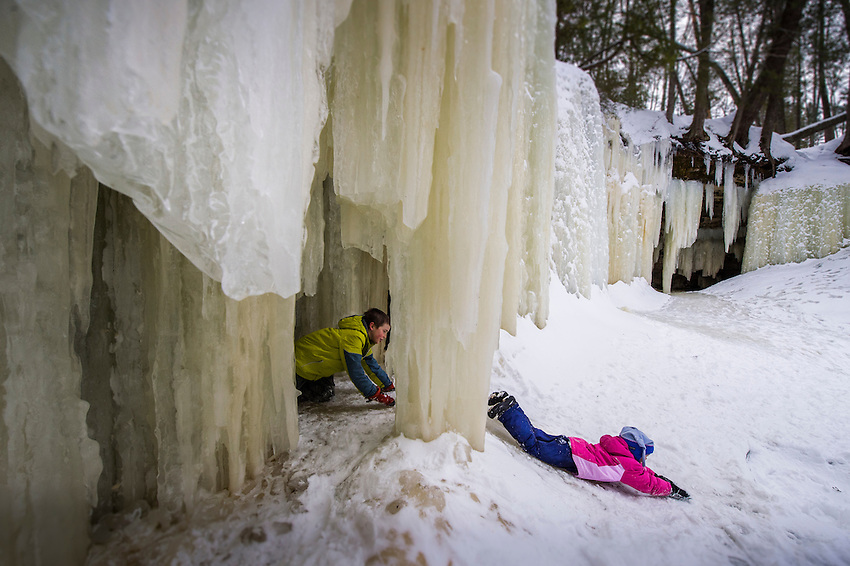 A family explores the Eben Ice Caves area of the Rock River Canyon in the Hiawatha National Forest on Michigan's Upper Peninsula.