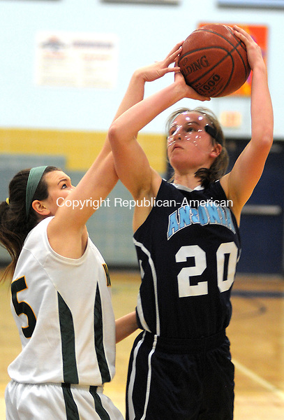 WATERBURY,  CT, 20 FEBRUARY  2012-022012JS17-Ansonia's Tierney Lawler (20) gets her shot partially blocked by Holy Cross' Nicole Bray (5) during their NVL Tournament semi-final game Monday at Kennedy High School in Waterbury. .Jim Shannon Republican-American