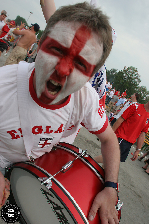 An English National Soccer Team supporters cheers and bangs a drum after England's 2-0 win over Trinadad and Tobago at the Nuremburg Fan Festival just outside the Nuremburg World Cup stadium on Thursday, June 15h, 2006.  England played Trinadad and Tobago in a first round FIFA World Cup group match in Nuremburg, Germany..