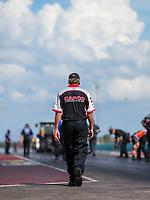 Oct 7, 2018; Ennis, TX, USA; Richard Hogan, crew chief for NHRA top fuel driver Steve Torrence during the Fall Nationals at the Texas Motorplex. Mandatory Credit: Mark J. Rebilas-USA TODAY Sports