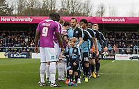Pre match handshakes during the Sky Bet League 2 match between Wycombe Wanderers and Barnet at Adams Park, High Wycombe, England on 16 April 2016. Photo by Andy Rowland.