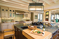A laid back coastal kitchen that still works hard - with built in butcher block cutting board for prep or gathering