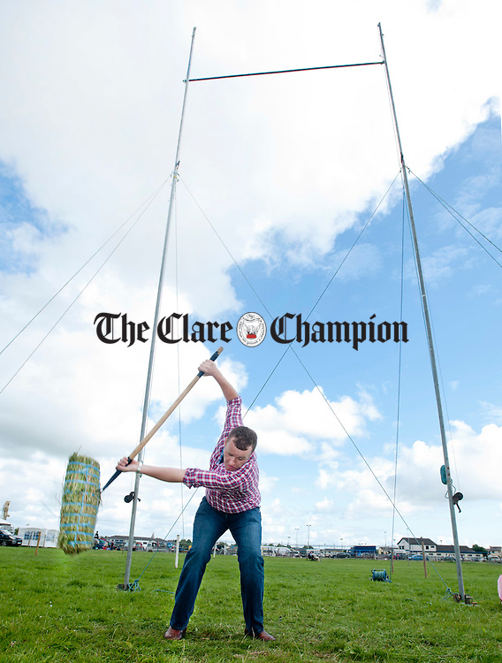 Richie Pilkington from Cree tries his hand at sheaf-throwing during the Clare County Show at the Ennis Showgrounds. Photograph by Declan Monaghan