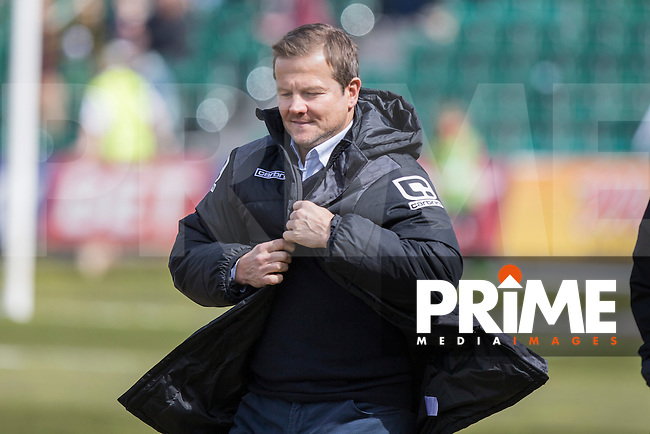 Notts County manager Mark Cooper puts on a jacket as he heads to the bench for the Sky Bet League 2 match between Newport County and Notts County at Rodney Parade, Newport, Wales on 30 April 2016. Photo by Mark  Hawkins / PRiME Media Images.