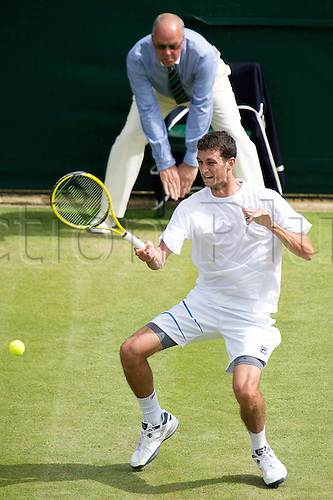 28.06.2012  The All England Lawn Tennis and Croquet Club. London, England. James Ward of Great Britain  in action against Mardy Fish of United States during second round at Wimbledon Tennis Championships at The All England Lawn Tennis and Croquet Club. London, England, UK
