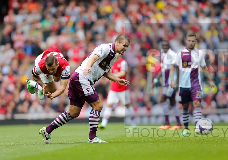 Arsenal's Jack Wilshere gets fouled by Villa's Ron Vlaar<br /> <br /> Arsenal v Aston Villa  - Barclays Premiership - Emirates Stadium - London - England -17/08/2013  - Pic David Klein/Sportimage