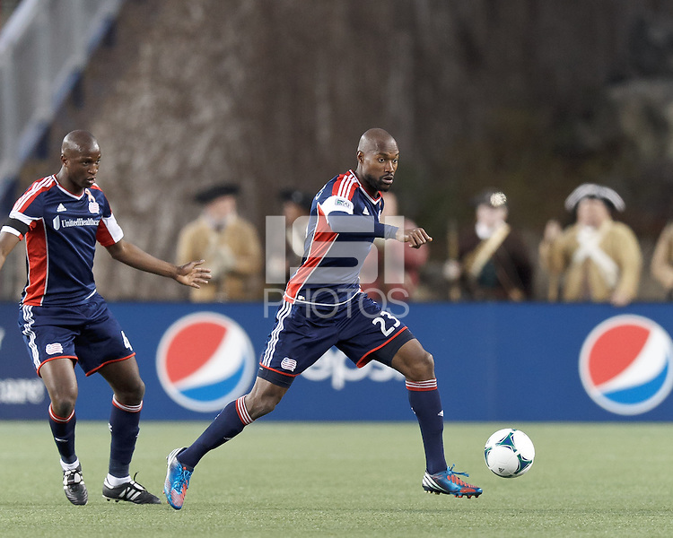 New England Revolution defender Jose Goncalves (23) brings the ball forward. In a Major League Soccer (MLS) match, the New England Revolution (blue/red) defeated Philadelphia Union (blue/white), 2-0, at Gillette Stadium on April 27, 2013.