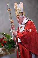 Pope Benedict XVI leads a solemn mass at St Peter's basilica to celebrate the feast of Saint Peter and Saint Paul on June 29, 2011 at The Vatican. Pope Benedict XVI placed palliums around the necks of 34 new metropolitan  archishops, a symbol of their authority and responsability