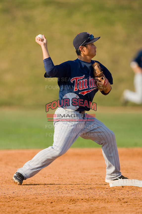 Second baseman Hyeong-Rok Choi #13 of the Elizabethton Twins makes a throw to first base against the Johnson City Cardinals at Howard Johnson Field July 3, 2010, in Johnson City, Tennessee.  Photo by Brian Westerholt / Four Seam Images