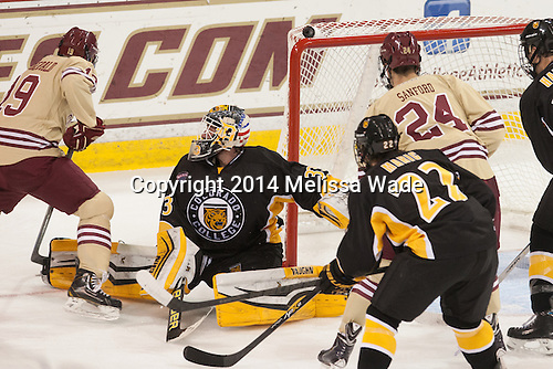 Ryan Fitzgerald (BC - 19) tucks the puck around Tyler Marble (CC - 33) and in. - The Boston College Eagles defeated the visiting Colorado College Tigers 6-2 on Friday, October 24, 2014, at Kelley Rink in Conte Forum in Chestnut Hill, Massachusetts.