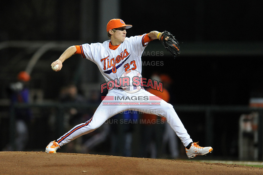 Clemson Tigers starting pitcher Daniel Gossett #23 delivers a pitch during a game against the South Carolina Gamecocks at Doug Kingsmore Stadium on March 1, 2013 in Clemson, South Carolina. The Gamecocks won 6-0.(Tony Farlow/Four Seam Images).