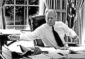 United States President Gerald R. Ford works in shirtsleeves at his desk in the Oval Office in the White House in Washington, D.C. on August 24, 1974.<br /> Mandatory Credit: David Hume Kennerly / White House via CNP