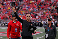 Former Ohio State linebacker James Laurinaitis waves to the crowd after being acknowledged at halftime for being inducted into the Ohio State Athletics Hall of Fame at the NCAA football game between Ohio State and Rutgers at Ohio Stadium on Saturday, September 8, 2018. At left is former Ohio State quarterback Ron Maciejowski and at right is Janine Oman, deputy Athletic Director. [Jonathan Quilter/Dispatch]