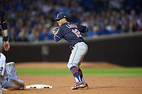 Cleveland Indians shortstop Francisco Lindor (12) throws to first base after forcing Kris Bryant (17) out in the fourth inning during Game 3 of the Major League Baseball World Series against the Chicago Cubs on October 28, 2016 at Wrigley Field in Chicago, Illinois.  (Mike Janes/Four Seam Images)