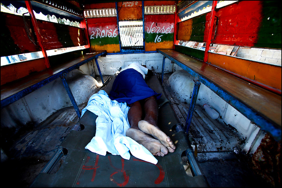 Nov 10, 2010 - Port-au-Prince, Haiti.A local residents suffering from cholera-like symptoms lies in the back of a tap-tap bus as officials argue about where to take her after she was taken from a small medical clinic set up in tents in the Cite Soleil area of Port-au-Prince, Haiti, Wednesday, November 10, 2010 as fears of a cholera outbreak spread through the area just two days after cases of the infection were confirmed in the area, the poorest slum in Haiti's capital. Officials from the Pan American Health Organization warn that Haiti's cholera epidemic, spread primarily through consuming infected water and food, is likely to grow much larger in the wake of Hurricane Tomas.  (Credit Image: Brian Blanco)