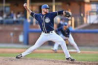 Asheville Tourists pitcher Alec Kenilvort (40) delivers a pitch during a game against the Hagerstown Suns at McCormick Field on April 28, 2016 in Asheville, North Carolina. The Tourists were leading the Suns 6-5 when the game was delayed in the top of the 6th inning due to darkness. (Tony Farlow/Four Seam Images)