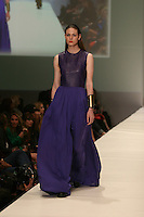 HOUSTON, TX - NOVEMBER 12 Model walks the runway during a Maison Rabih Kayrouz show on day one of Fashion Houston Spring 2013 Presented By Audi at the Wortham Theatre Center on November 12, 2012 in Houston, Texas. (Photo by Louis Dollagaray/MediaPunch inc) /NortePhoto