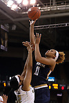 18 February 2016: Notre Dame's Brianna Turner (11) shoots over Wake Forest's Milan Quinn (32). The Wake Forest University Demon Deacons hosted the University of Notre Dame Fighting Irish at Lawrence Joel Veterans Memorial Coliseum in Winston-Salem, North Carolina in a 2015-16 NCAA Division I Women's Basketball game. Notre Dame won the game 86-52.