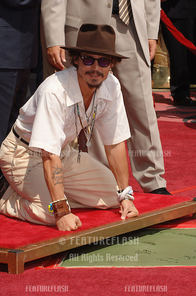 Actor JOHNNY DEPP at Grauman's Chinese Theatre, Hollywood, where he had his hands & footprints set in cement..His latest movie, the animated feature Corpse Bride, opens today..September 16, 2005  Los Angeles, CA..© 2005 Paul Smith / Featureflash