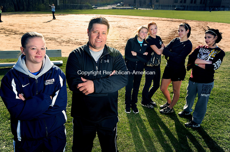 THOMASTON. CT, 03 APRIL  2012-040312JS02-Thomaston High School softball coach Gene Torrance, second from left, with co-coach Kelly Fowler, left, and some of their players, Alexa Torrance, Shannon April, Karley Conway and Bianca Durante..Jim Shannon Republican-American