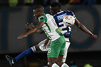BOGOTA - COLOMBIA, 31-01-2018: Jader Valencia (Der) jugador de Millonarios disputa el balón con Helibelton Palacios (Izq) jugador de Atlético Nacional durante partido partido por la final ida de la SuperLiga Aguila 2018jugado en el estadio Nemesio Camacho El Campin de la ciudad de Bogotá. / Jader Valencia (R) player of Millonarios fights for the ball with Helibelton Palacios (L) player of Atletico Nacional during the first leg match for the final of the SuperLiga Aguila 2018played at the Nemesio Camacho El Campin Stadium in Bogota city. Photo: VizzorImage / Gabriel Aponte / Staff.