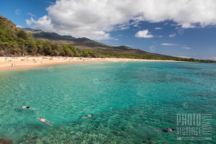 Snorkelers and beachgoers enjoy a clear day at Makena Beach, Maui.