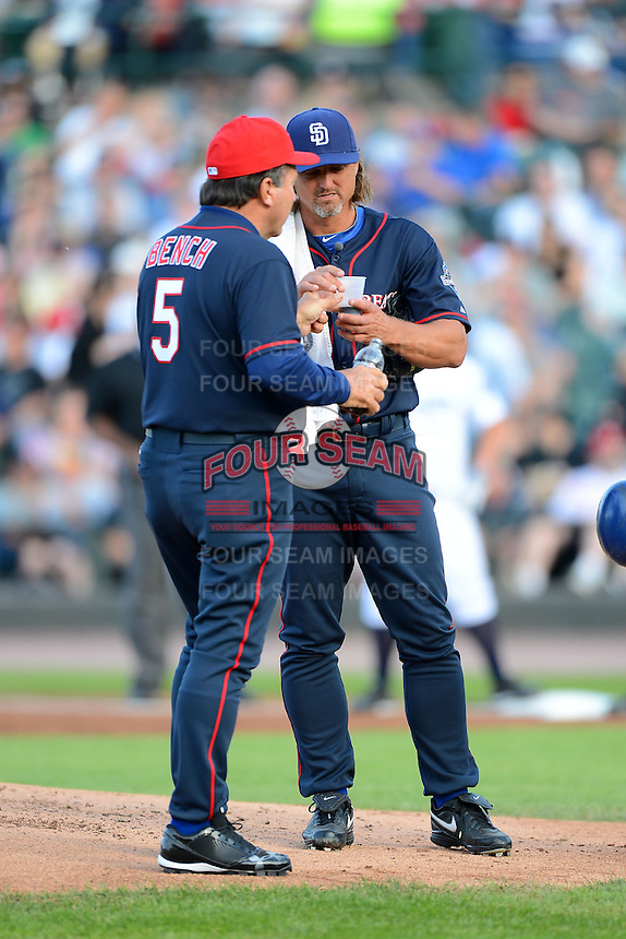 Hall of Fame catcher Johnny Bench brings former San Diego Padres closer Trevor Hoffman a drink of Pepsi Max in the middle of the inning during the MLB Pepsi Max Field of Dreams game on May 18, 2013 at Frontier Field in Rochester, New York.  (Mike Janes/Four Seam Images)