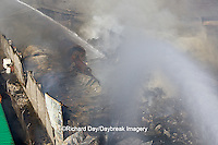 63818-02404 Firefighters extinguishing warehouse fire using aerial ladder truck viewed from top of ladder, Salem, IL