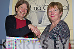 FAREWELL: Jane Cunningham (left), a special needs assistant at Coars NS in Cahersiveen receiving a farewell gift from principal, Marian Murphy on Friday. Jane was an SNA at the school for six years.